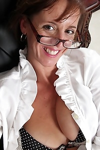 Busty cougar Karen Smith gets naked at the office.