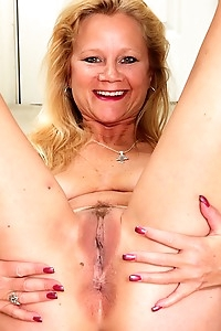 Older wife Ali Jones strips naked after work.