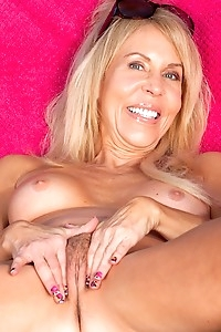 Busty cougar Carmen Caliente gets naked outdoors.