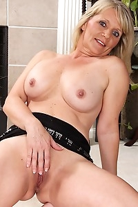Blond cougar Aubrey Adams spreads trimmed pussy.