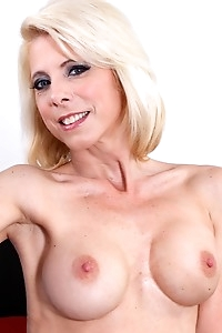 Sexy mature blond babe Jodie Stacks exposes firm tits.