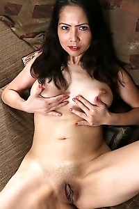 Mature Asian babe Emmeline Johnson toying her tight twat.