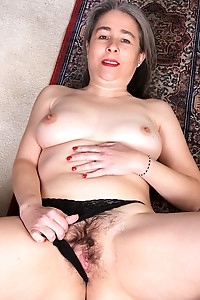 Older amateur Lexy Lou spreading her hairy pussy.