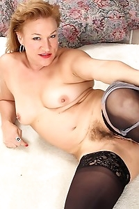 Mature babe Sabina Wexler spreads her hairy older pussy.