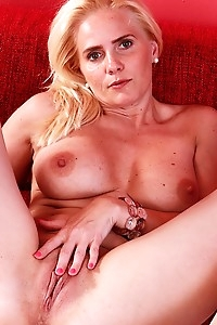 Busty older babe Sevikova toys her mature pussy.