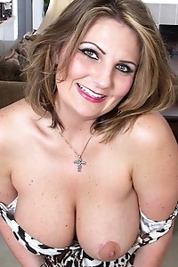 Horny wife Cherrie Dixon exposes her big mature tits.
