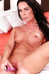 Busty cougar Alicia dildos her moist pussy.