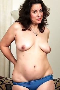Mature Latina Gianna Jones spreads her hairy pussy.