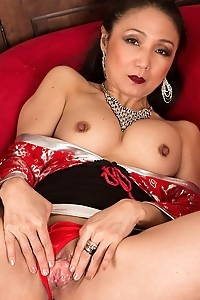 Mature Asian babe Aya May rubbing her clit.
